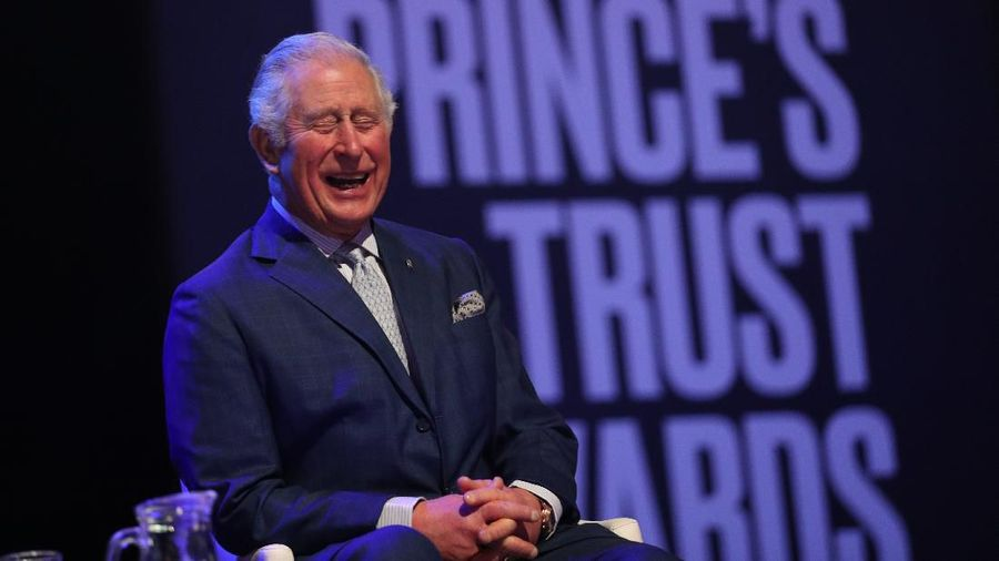 LONDON, ENGLAND - MARCH 11: Prince Charles, Prince of Wales uses the Namaste gesture to greet Anna Friel and Pierce Brosnan as he attends the Princes Trust And TK Maxx & Homesense Awards at London Palladium on March 11, 2020 in London, England. (Photo by Yui Mok - WPA Pool/Getty Images)