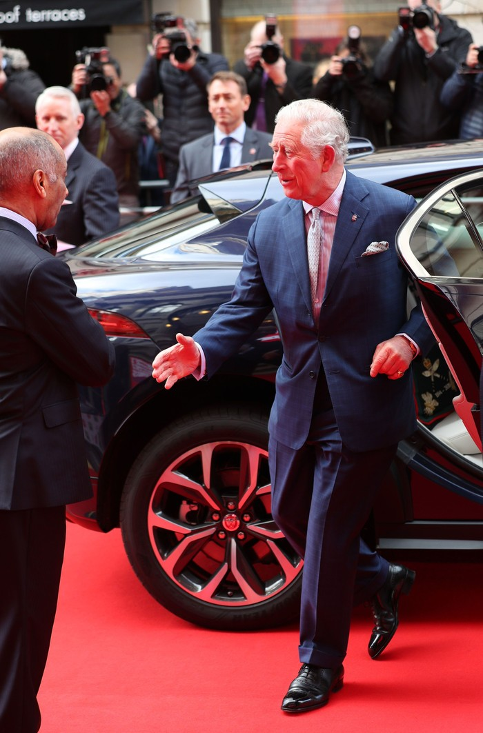 LONDON, ENGLAND - MARCH 11: Prince Charles, Prince of Wales goes to shake the hand of Sir Kenneth Olisa, The Lord-Lieutenant of Greater London (left) before he changes to use a Namaste gesture, as he arrives at the annual Prince's Trust And TK Maxx & Homesense Awards at London Palladium on March 11, 2020 in London, England. (Photo by Yui Mok - WPA Pool/Getty Images)
