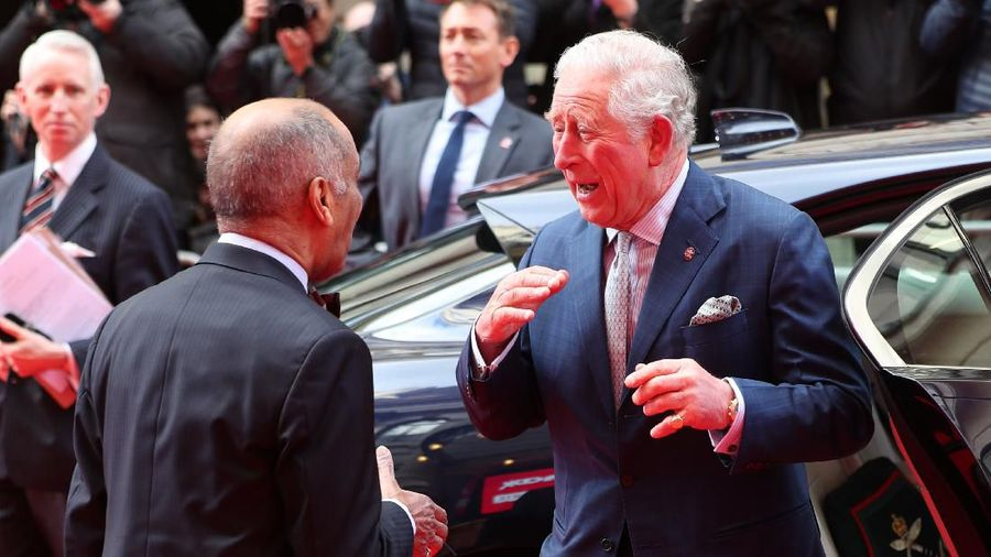 LONDON, ENGLAND - MARCH 11: Prince Charles, Prince of Wales goes to shake the hand of Sir Kenneth Olisa, The Lord-Lieutenant of Greater London (left) before he changes to use a Namaste gesture, as he arrives at the annual Princes Trust And TK Maxx & Homesense Awards at London Palladium on March 11, 2020 in London, England. (Photo by Yui Mok - WPA Pool/Getty Images)