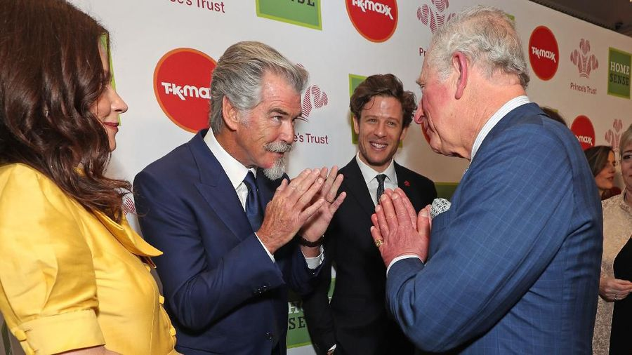 LONDON, ENGLAND - MARCH 11: Prince Charles, Prince of Wales uses the Namaste gesture to greet television presenters Ant McPartlin (L) and Declan Donnelly as he attends the Princes Trust And TK Maxx & Homesense Awards at London Palladium on March 11, 2020 in London, England. (Photo by Yui Mok - WPA Pool/Getty Images)