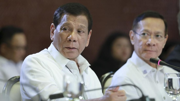 In this March 9, 2020, photo provided by the Malacanang Presidential Photographers Division, Philippine President Rodrigo Duterte, left, talks beside Health Secretary Francisco Duque II during a meeting with the Inter-Agency Task Force for the Management of Emerging Infectious Diseases at the Malacanang Palace in Manila, Philippines. Duterte has declared a state of public health emergency throughout the country after health officials confirmed over the weekend the first local transmission of the new coronavirus. (Robinson Ninal Jr./Malacanang Presidential Photographers Division via AP)