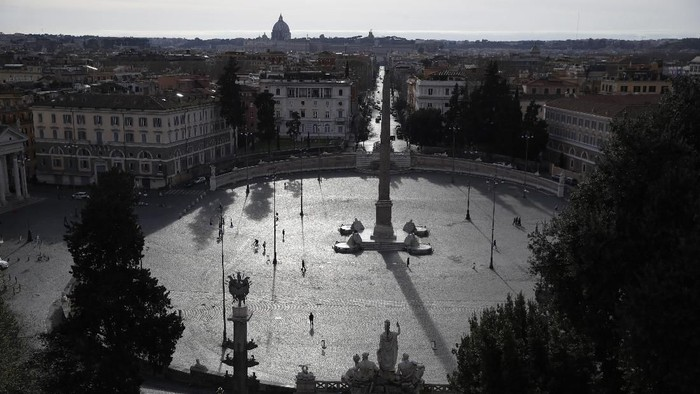 A view of an almost deserted Piazza del Popolo square in Rome, Thursday, March 12, 2020. A sweeping lockdown is in place in Italy to try to prevent it from becoming the next epicenter of the coronavirus epidemic. For most people, the new coronavirus causes only mild or moderate symptoms. For some, it can cause more severe illness, especially in older adults and people with existing health problems. (AP Photo/Alessandra Tarantino)