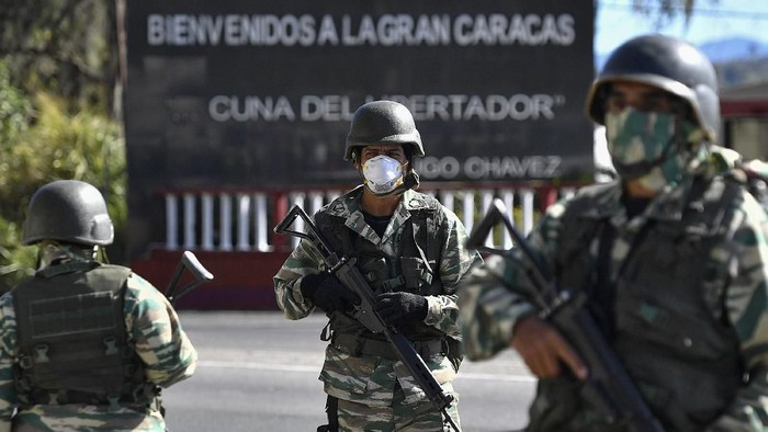 A member of the Venezuelan military take part in a military drill to block access to the countrys capital in case a spread of the coronavirus in Caracas, Venezuela, Sunday, March 15, 2020 For most people, the new coronavirus causes only mild or moderate symptoms. For some it can cause more severe illness. (AP Photo/Matias Delacroix)