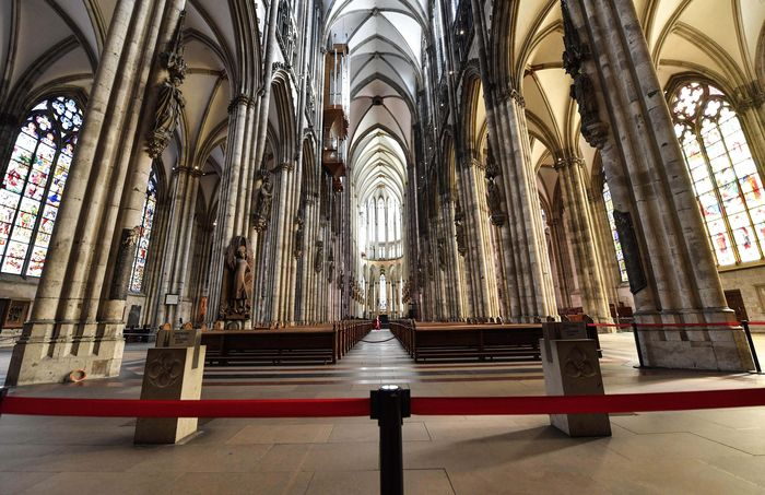 A man prays in the empty world famous Cologne Cathedral in Cologne, Germany, on Sunday, March 15, 2020. The church cancelled all worship services and is open only for single prayers and closed for visitors due to the coronavirus outbreak. The vast majority of people recover from the new coronavirus. According to the World Health Organization, most people recover in about two to six weeks, depending on the severity of the illness. (AP Photo/Martin Meissner)
