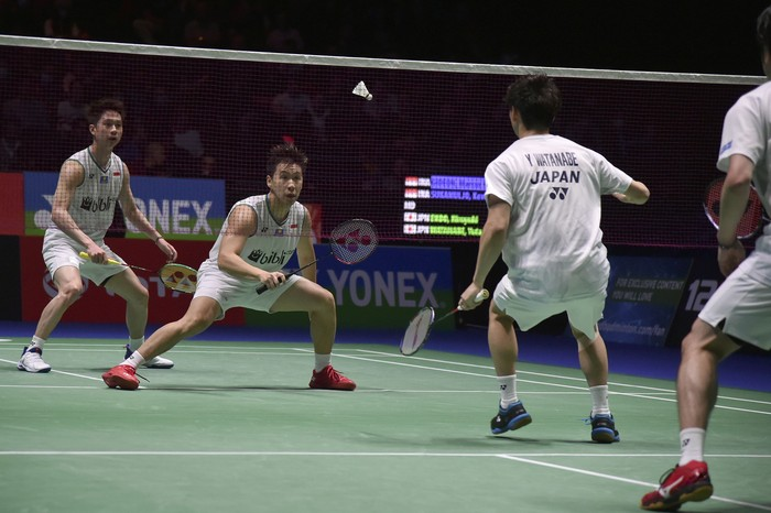 Kevin Sanjaya Sukamuljo, left, and Marcus Fernaldi Gideon of Indonesia play Hiroyuki Endo, right, and Yuta Watanabe of Japan during the Mens Doubles final match at the All England Open Badminton tournament in Birmingham, England, Sunday, March 15, 2020. (AP Photo/Rui Vieira)