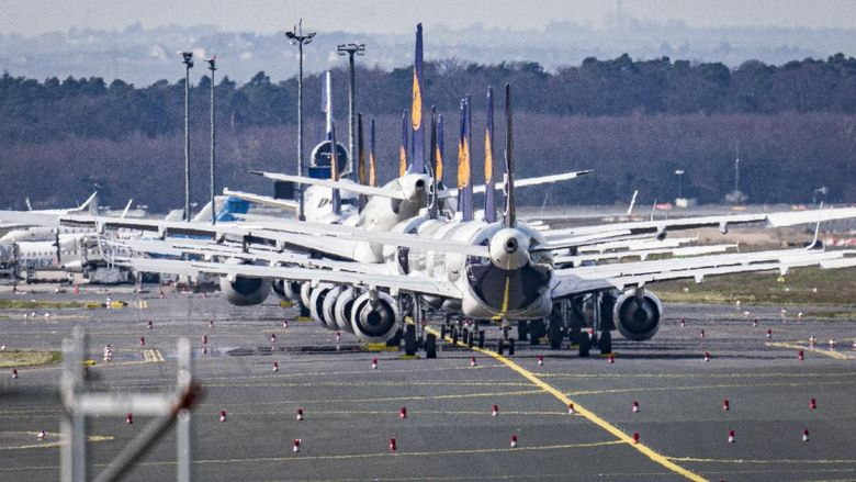 Aircrafts are parked on a runway at the airport in Frankfurt, Germany, Sunday, March 15, 2020. Due to the Coronavirus, Lufthansa had to cancel half of its flights. For most people, the new coronavirus causes only mild or moderate symptoms. For some, it can cause more severe illness, especially in older adults and people with existing health problems. (AP Photo/Michael Probst)