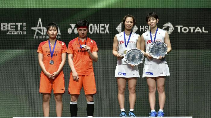 Du Yue and Li Yin Hui of China and Yuki Fukushima and Sayaka Hirota, from Japan, from left, poses with their medals after their Womens Doubles final match at the All England Open Badminton tournament in Birmingham, England, Sunday, March 15, 2020. The Japanese team won 2-0. (AP Photo/Rui Vieira)