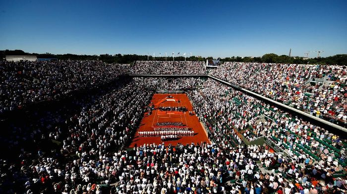 PARIS, FRANCE - JUNE 10:  A general view as Jelena Ostapenko of Latvia is awarded the trophy following victory in  the ladies singles final match against Simona Halep of Romania on day fourteen of the 2017 French Open at Roland Garros on June 10, 2017 in Paris, France.  (Photo by Adam Pretty/Getty Images)