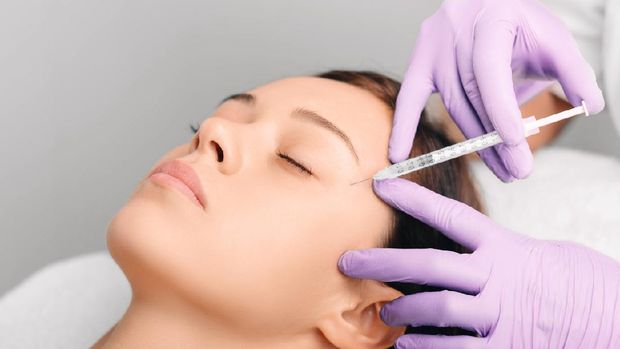 Beautiful young woman having aesthetic treatment in medical office, Corrective medicine concept