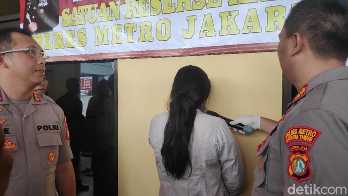 Tersangka penyebar video viral hoax terkait virus Corona di Pusat Grosir Cililitan (PGC), Jakarta Timur,