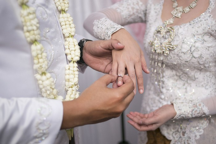 Pasang Cincin on Javanese Wedding. Traditional Javanese Groom Puts a Ring On The Bride