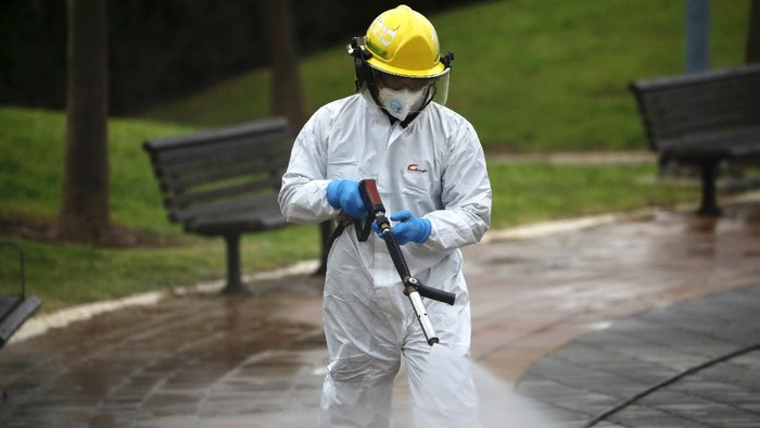 An Israeli firefighter sprays disinfectant as a precaution against the coronavirus in Modiin, Israel, Tuesday, March 17, 2020. The head of Israels shadowy Shin Bet internal security service said Tuesday that his agency received Cabinet approval overnight to start deploying its counter-terrorism tech measures to help curb the spread of the new coronavirus in Israel. For most people, the new coronavirus causes only mild or moderate symptoms. For some it can cause more severe illness. (AP Photo/Ariel Schalit)