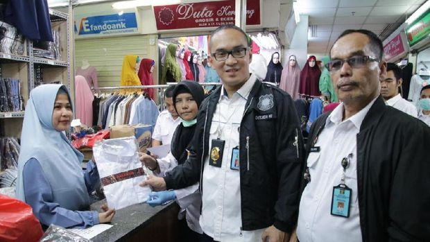 Razia Merek di Pasar Tanah Abang, DJKI Sita Puluhan Baju Gamis 'Wakanda'