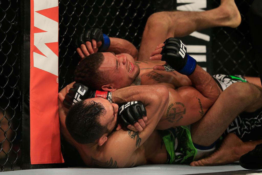 LAS VEGAS, NV - DECEMBER 06:  Tony Ferguson celebrates after defeating Abel Trujillo in their fight during the UFC 181 event at the Mandalay Bay Events Center on December 6, 2014 in Las Vegas, Nevada.  (Photo by Alex Trautwig/Getty Images)