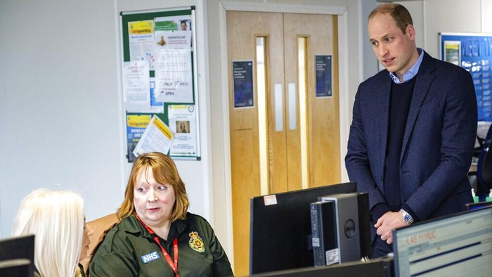 In this Thursday, March 19, 2020 photo released by Kensington Palace, Britains Prince William, centre right and Kate, the Duchess of Cambridge talk with staff,  during a visit to the London Ambulance Service 111 control room in Croydon, South London. The couple met with  ambulance staff and 111 call handlers who have been taking NHS 111 calls from the public in the wake of the coronavirus outbreak. (Kensington Palace via AP)