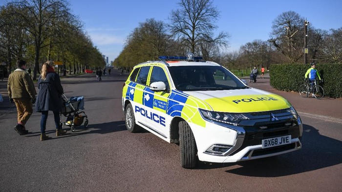 LONDON, ENGLAND  - MARCH 22: A Police car is seen parked at the gates to Greenwich Park on March 22, 2020 in London, United Kingdom. British Prime Minister Boris Johnson urged that people dont visit their parents this Mothering Sunday to curb the spread of COVID-19, which has killed 233 people in the UK.  (Photo by Peter Summers/Getty Images)