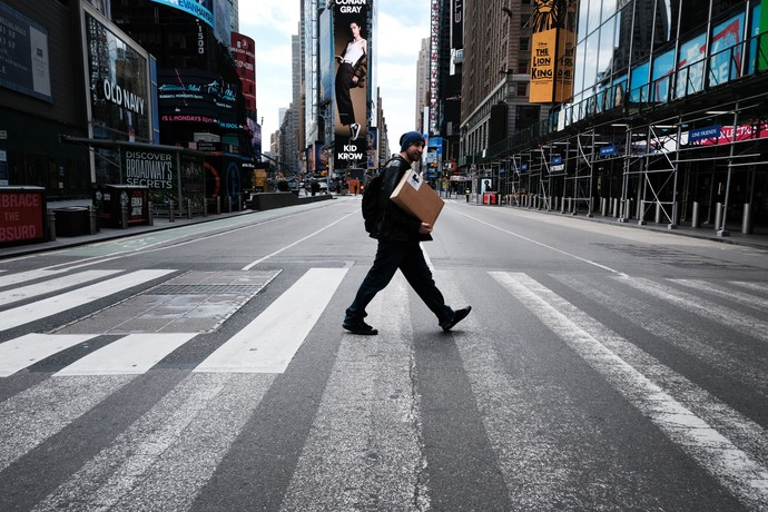NEW YORK, NY - MARCH 22: Times Square stands mostly empty as  as much of the city is void of cars and pedestrians over fears of spreading the coronavirus on March 22, 2020 in New York City. Across the country schools, businesses and places of work have either been shut down or are restricting hours of operation as health officials try to slow the spread of COVID-19. (Photo by Spencer Platt/Getty Images)