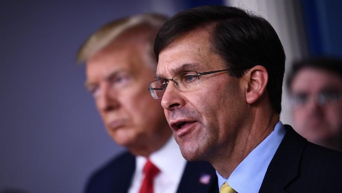 (FILES) In this file photo US Defense Secretary Mark Esper speaks during the daily briefing on the novel coronavirus, COVID-19, at the White House on March 18, 2020, in Washington, DC. - US Defense Secretary Mark Esper confirmed March 23, 2020 that the military had rescued an American victim of violent crime in Honduras. President Donald Trump said cryptically Sunday that the US military had secured the release of the woman, but gave no details.We were able to get a young woman released from a certain area who was being horribly accosted, horribly treated, Trump said. (Photo by Brendan Smialowski / AFP)