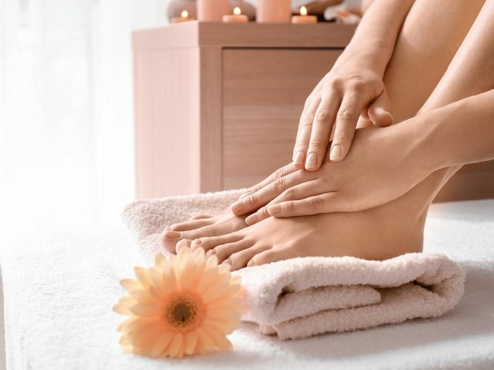 Young woman with beautiful pedicure and manicure after treatment in spa salon