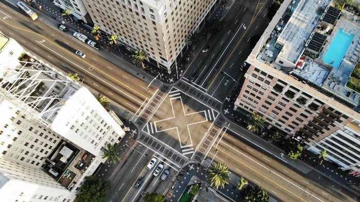 LOS ANGELES, CALIFORNIA  - MARCH 25: An aerial view shows the intersection of Hollywood and Vine, shortly before sunset, with lighter than normal traffic as the coronavirus pandemic continues on March 25, 2020 in Los Angeles, California. California Governor Gavin Newsom issued a 'stay at home' order for California's 40 million residents, with exceptions for essential activities, in order to slow the spread of COVID-19. (Photo by Mario Tama/Getty Images)