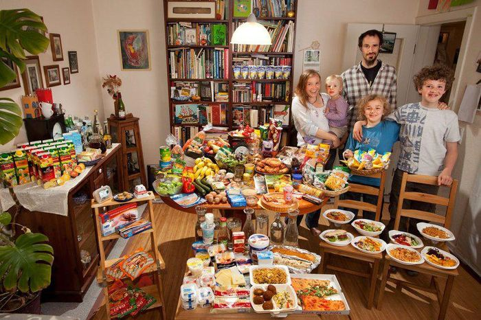 The Sturm Family of Hamburg, Germany. Astrid Hollmann, 38, and Michael Sturm, 38, and their three children Lenard, 12, Malte Erik, 10, and Lillith, 2.5, with their typical week's worth of food in June. 