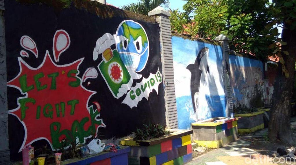 Saat Seniman Palabuhanratu Sampaikan Pesan Lawan Corona Lewat Mural