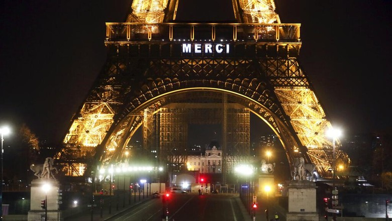 The word Merci, the French word for Thank you, is emblazoned on the Eiffel Tower as Frances coronavirus death toll continued to climb, in Paris, Friday, March 27, 2020. Health workers fighting to save lives in France from COVID-19 have received a huge show of gratitude, from the Eiffel Tower. The new coronavirus causes mild or moderate symptoms for most people, but for some, especially older adults and people with existing health problems, it can cause more severe illness or death. (AP Photo/Thibault Camus)