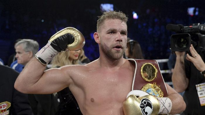 """FILE - In this Dec. 16, 2017, file photo, Billy Joe Saunders, of Britain, celebrates his win over David Lemieux, of Canada, to retain the WBO middleweight boxing title in Laval, Quebec. Saunders had his boxing license suspended Monday, March 30, 2020, after publishing a social media video in which he appeared to condone domestic violence amid the coronavirus outbreak. He has apologized for his remarks, saying: """"It was a silly mistake but I didnt mean to cause any harm to anyone and I certainly wouldnt promote domestic violence.""""(Ryan Remiorz/The Canadian Press via AP)"""