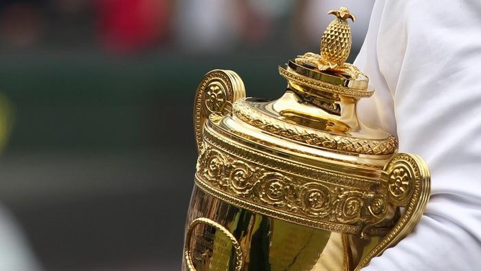 Spanish player Rafael Nadal holds the trophy after beating Czech player Tomas Berdych during the mens singles grand final of the Wimbledon Tennis Championships at the All England Tennis Club, in southwest London on July 4,  2010.   AFP PHOTO / GLYN KIRK (Photo by GLYN KIRK / AFP)