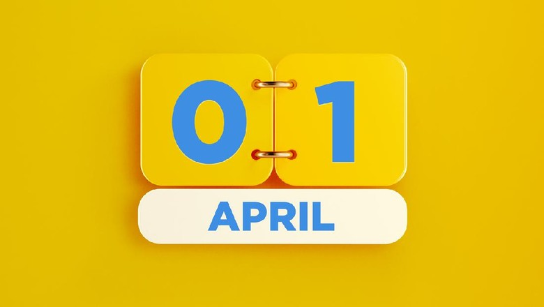 Yellow calendar on yellow background. April 1 writes on the calendar. Horizontal composition with copy space. Top view.