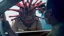 Viral Polisi India Pakai Helm Corona, Takuti Warga agar #Dirumahaja