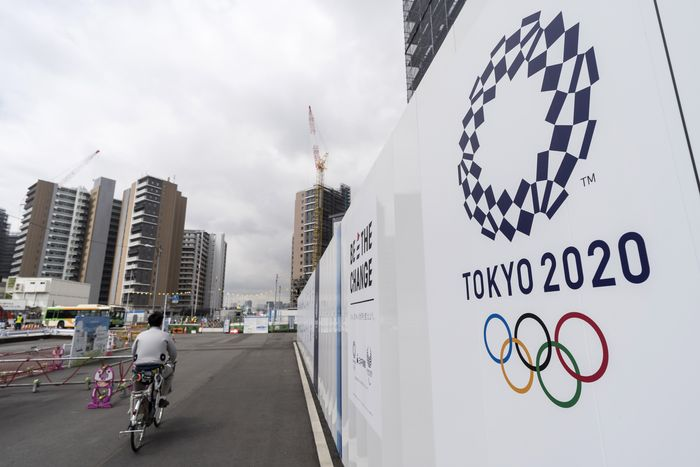 TOKYO, JAPAN - JULY 24: A worker rides a bicycle through the Olympic and Paralympic Village under construction on July 24, 2019 in Tokyo, Japan. (Photo by Tomohiro Ohsumi/Getty Images)