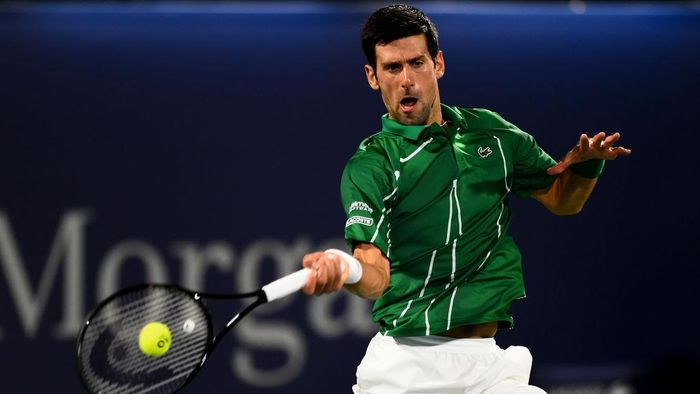 DUBAI, UNITED ARAB EMIRATES - FEBRUARY 29: Novak Djokovic of Serbia plays a forehand during his mens final match against Stefanos Tsitsipas of Greece on Day 13 of the Dubai Duty Free Tennis at Dubai Duty Free Tennis Stadium on February 29, 2020 in Dubai, United Arab Emirates (Photo by Tom Dulat/Getty Images)