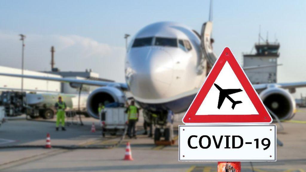 Lindungi Diri dari Corona, Traveler Ini Pakai Tenda di Pesawat