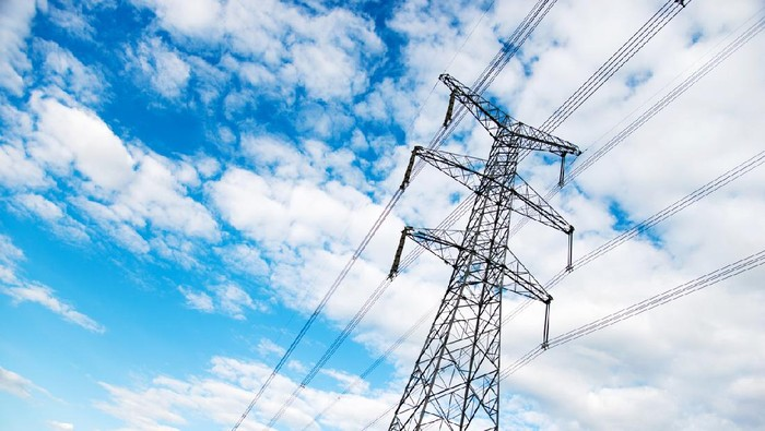 Electricity pylons under the blue sky