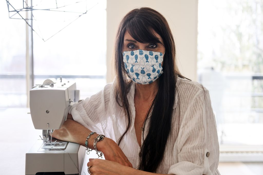 Women sewing protective mask, Quebec, Canada