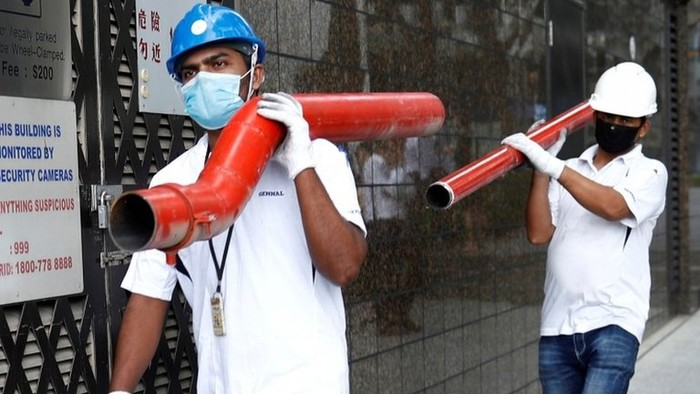 Virus corona: Singapura karantina 20.000 pekerja migran, tak ada pekerja asal Indonesia yang terdampak