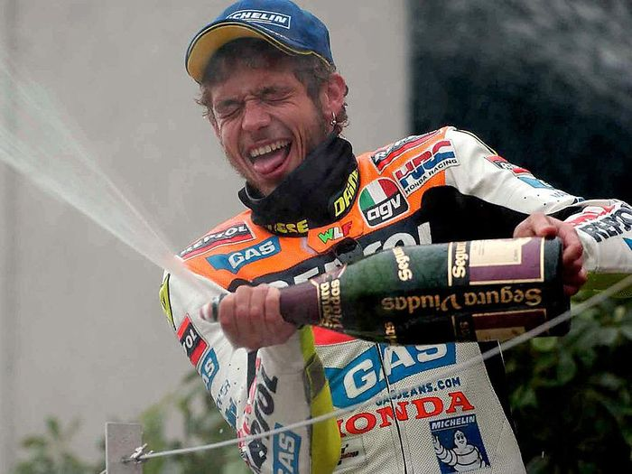 7 Apr 2002 . Valentino Rossi of Italy celebrates on the podium after winning the first round of the 500cc Motor cycle championship held at the Suzuka Circuit in Japan   DIGITAL IMAGE. Mandatory Credit: Grazia Neri/Getty Images