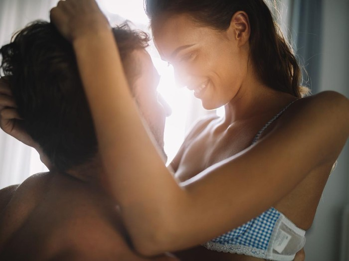 Young beautiful hot couple in love hugging and kissing. Beautiful woman and handsome muscular man close to each other in happy pose.
