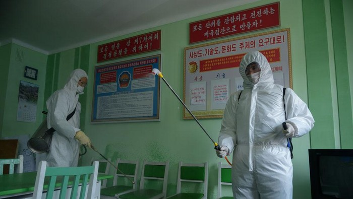 Health officials disinfect an office room amid concerns over the COVID-19 coronavirus at the Pyongchon District Peoples Hospital in Pyongyang on April 1, 2020. (Photo by KIM Won Jin / AFP) (Photo by KIM WON JIN/AFP via Getty Images)