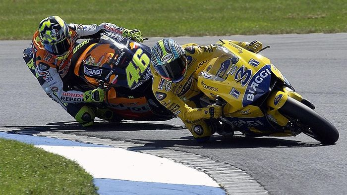 DONINGTON, ENGLAND - JULY 13:  Max Biaggi of Italy and Camel Honda leads Valentino Rossi of Italy and Repsol Honda during the Cinzano British MotoGP on July 13, 2003 at Donington Park, England. (Photo by Dan Regan/Getty Images).