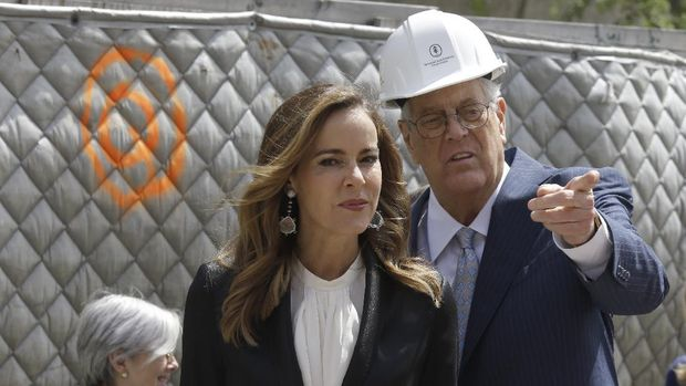 David H. Koch, right, and his wife Julia take in the sight of the future David H. Koch Center for Cancer Care during a