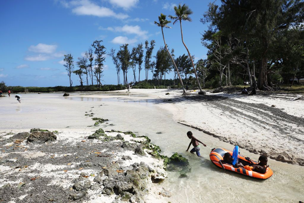 EFATE, VANUATU - NOVEMBER 30: Kids play at Eton Beach on November 30, 2019 in Efate, Vanuatu. Satellite data show sea level has risen about 6mm per year around Vanuatu since 1993, a rate nearly twice the global average, while temperatures have been increasing since 1950. 25 percent of Vanuatu's 276,000 citizens lost their homes in 2015 when Cyclone Pam, a category 5 storm, devastated the South Pacific archipelago of 83 islands while wiping out two-thirds of its GDP. Scientists have forecast that the strength of South Pacific cyclones will increase because of global warming. Vanuatu's government is considering suing the world's major pollution emitters in a radical effort to confront global warming challenges and curb global emissions, to which it is a very small contributor. (Photo by Mario Tama/Getty Images)