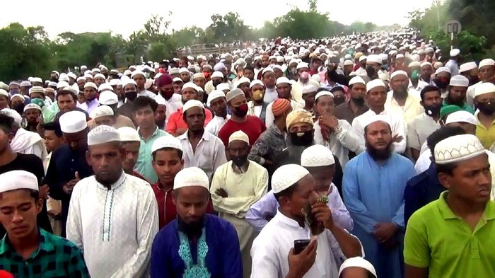 In this Saturday, April 18, 2020 photo, thousands of Bangladeshi Muslims gather to attend the funeral of a popular Islamic preacher defying a nationwide lockdown to curb the spread of the new coronavirus at the central district of Brahmanbaria, Bangladesh. Bangladesh, a nation of 160 million people, is struggling to enforce ban on large gatherings. (AP Photo/Masuk Hridoy)