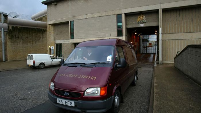 WAKEFIELD, ENGLAND - JANUARY 13: A funeral director van leaves Wakefield prison where convicted serial killer Dr Harold Shipman was found dead hanging in his cell on January 13, 2004. Shipman, nicknamed