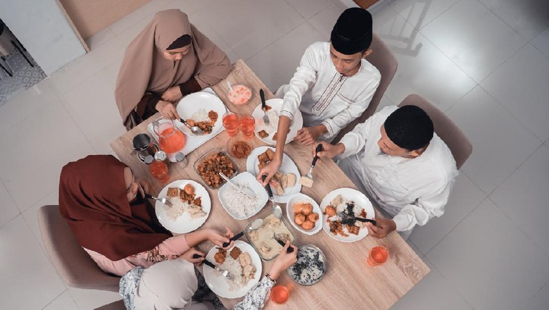 top view muslim family enjoy the iftar meal dinner together in dining room
