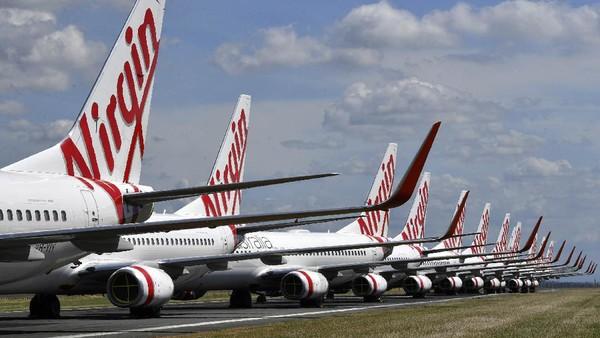Maskapai Virgin Australia menyatakan diri bangkrut pada tanggal 21 April, bulan lalu. Maskapai ini sudah menghentikan seluruh operasionalnya gegara Corona dan tengah melakukan restrukturisasi perusahaan. (AP/Darren England)