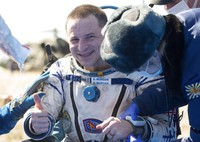 In this handout photo released by Gagarin Cosmonaut Training Centre (GCTC), Roscosmos space agency, U.S. astronauts Andrew Morgan, left, Jessica Meir, right, and Russian cosmonaut Oleg Skripochka sit in chairs shortly after the landing of the Russian Soyuz MS-15 space capsule near Kazakh town of Dzhezkazgan, Kazakhstan, Friday, April 17, 2020. An International Space Station crew has landed safely after more than 200 days in space. The Soyuz capsule carrying NASA astronauts Andrew Morgan, Jessica Meir and Russian space agency Roscosmos Oleg Skripochka touched down on Friday on the steppes of Kazakhstan. (Andrey Shelepin, Gagarin Cosmonaut Training Centre (GCTC), Roscosmos space agency, via AP)