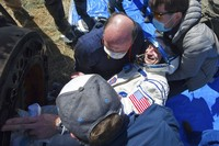 In this handout photo released by Gagarin Cosmonaut Training Centre (GCTC), Roscosmos space agency, rescue team members get out of the capsule U.S. astronaut Andrew Morgan shortly after the landing of the Russian Soyuz MS-15 space capsule near Kazakh town of Dzhezkazgan, Kazakhstan, Friday, April 17, 2020. An International Space Station crew has landed safely after more than 200 days in space. The Soyuz capsule carrying NASA astronauts Andrew Morgan, Jessica Meir and Russian space agency Roscosmos Oleg Skripochka touched down on Friday on the steppes of Kazakhstan. (Andrey Shelepin, Gagarin Cosmonaut Training Centre (GCTC), Roscosmos space agency, via AP)