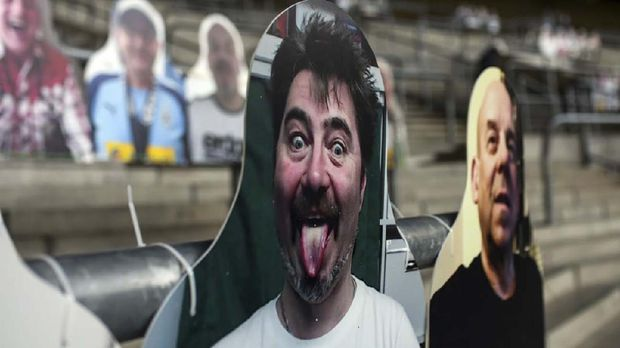 Cardboard cut-outs with portraits of Borussia Moenchegladbach's supporters are seen at the Borussia Park football stadium in Moenchengladbach, western Germany, on April 16, 2020, amid the novel coronavirus COVID-19 pandemic. - Large-scale public events such as football matches will remain banned in Germany until August 31 due to the coronavirus crisis, Berlin said on Wednesday, April 15, 2020, though it did not rule out allowing Bundesliga games to continue behind closed doors. (Photo by Ina FASSBENDER / AFP)